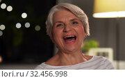 Купить «portrait of happy senior woman at home in evening», видеоролик № 32456998, снято 18 ноября 2019 г. (c) Syda Productions / Фотобанк Лори
