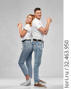 Купить «couple in white t-shirts shirts making gun gesture», фото № 32463950, снято 6 октября 2019 г. (c) Syda Productions / Фотобанк Лори