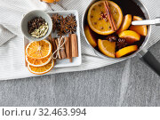 Купить «pot with hot mulled wine, orange slices and spices», фото № 32463994, снято 4 октября 2018 г. (c) Syda Productions / Фотобанк Лори