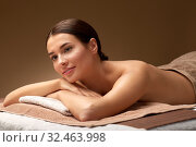 Купить «young woman lying at spa salon or massage parlor», фото № 32463998, снято 13 октября 2019 г. (c) Syda Productions / Фотобанк Лори