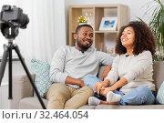 Купить «couple of video bloggers with camera at home», фото № 32464054, снято 22 сентября 2019 г. (c) Syda Productions / Фотобанк Лори