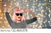 Купить «happy woman in pink wig and sunglasses dancing», фото № 32464078, снято 30 сентября 2019 г. (c) Syda Productions / Фотобанк Лори