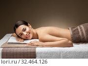 Купить «young woman lying at spa or massage parlor», фото № 32464126, снято 13 октября 2019 г. (c) Syda Productions / Фотобанк Лори