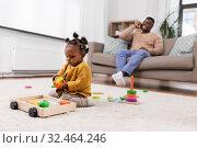 Купить «african baby girl playing with toy blocks at home», фото № 32464246, снято 29 сентября 2019 г. (c) Syda Productions / Фотобанк Лори