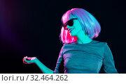 Купить «happy woman in pink wig and sunglasses dancing», фото № 32464262, снято 30 сентября 2019 г. (c) Syda Productions / Фотобанк Лори