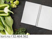 Купить «green vegetables and diary with empty pages», фото № 32464362, снято 12 апреля 2018 г. (c) Syda Productions / Фотобанк Лори