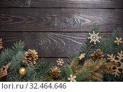Купить «fir branches with Christmas decor on old dark wooden background», фото № 32464646, снято 14 ноября 2019 г. (c) Майя Крученкова / Фотобанк Лори