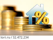 Купить «Символ процента  и недвижимости на фоне денег», фото № 32472234, снято 27 января 2020 г. (c) Сергеев Валерий / Фотобанк Лори