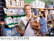 Caring boy visiting shop in search of dry food. Стоковое фото, фотограф Яков Филимонов / Фотобанк Лори