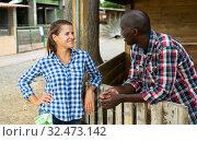 Купить «Woman and man chatting near stable», фото № 32473142, снято 9 декабря 2019 г. (c) Яков Филимонов / Фотобанк Лори