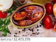 Купить «Stuffed squid in American sauce with greens and tomatoes at table», фото № 32473378, снято 21 февраля 2020 г. (c) Яков Филимонов / Фотобанк Лори
