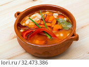 Купить «Soup of bean with boiled carrots, pepper and greens, served in bowl», фото № 32473386, снято 8 июля 2020 г. (c) Яков Филимонов / Фотобанк Лори