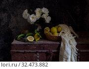 Купить «Still life with roses on a old box and lemons close-up», фото № 32473882, снято 4 ноября 2019 г. (c) Татьяна Ляпи / Фотобанк Лори