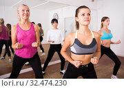 Купить «Ordinary active females exercising dance moves», фото № 32474230, снято 21 сентября 2019 г. (c) Яков Филимонов / Фотобанк Лори