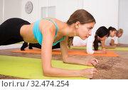 Купить «Women keep balance in asana on yoga», фото № 32474254, снято 21 сентября 2019 г. (c) Яков Филимонов / Фотобанк Лори