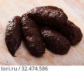 Купить «Blood sausages on wooden table», фото № 32474586, снято 8 апреля 2020 г. (c) Яков Филимонов / Фотобанк Лори