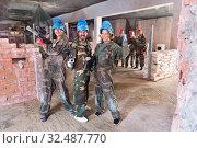 Купить «Team is enjoying victory in paintball club», фото № 32487770, снято 10 июля 2017 г. (c) Яков Филимонов / Фотобанк Лори