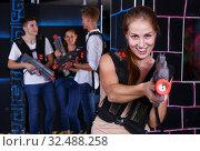 Купить «Smiling girl with laser pistol during enjoying laser tag game with her friends», фото № 32488258, снято 27 августа 2018 г. (c) Яков Филимонов / Фотобанк Лори
