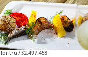 Купить «Tasty baked rainbow trout steaks with potatoes and greens on white plate», фото № 32497458, снято 4 июля 2020 г. (c) Яков Филимонов / Фотобанк Лори