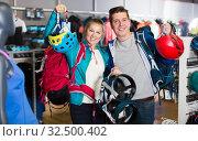Купить «Modern couple is choosing travel gear in shop», фото № 32500402, снято 25 октября 2017 г. (c) Яков Филимонов / Фотобанк Лори