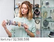 Купить «Saleswoman demonstrating bracelets from precious stones», фото № 32500598, снято 7 декабря 2019 г. (c) Яков Филимонов / Фотобанк Лори
