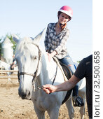 Купить «Positive mature couple with jockey learn to riding horse at farm», фото № 32500658, снято 12 декабря 2019 г. (c) Яков Филимонов / Фотобанк Лори