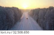Купить «Aerial video view from drone of a Sunrise over snowy winter road. Siberia, Russia», видеоролик № 32508650, снято 2 ноября 2019 г. (c) Serg Zastavkin / Фотобанк Лори