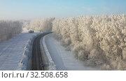 Купить «Aerial video view from drone of a Sunrise over snowy winter road. Siberia, Russia», видеоролик № 32508658, снято 5 ноября 2019 г. (c) Serg Zastavkin / Фотобанк Лори