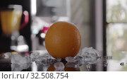 Купить «An orange in ice», видеоролик № 32508754, снято 3 апреля 2020 г. (c) Данил Руденко / Фотобанк Лори