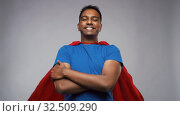 Купить «happy smiling indian man in red superhero cape», видеоролик № 32509290, снято 26 ноября 2019 г. (c) Syda Productions / Фотобанк Лори