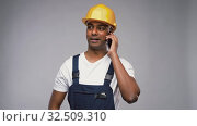 Купить «indian builder in helmet calling on smartphone», видеоролик № 32509310, снято 26 ноября 2019 г. (c) Syda Productions / Фотобанк Лори
