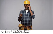 Купить «indian builder in helmet calling on smartphone», видеоролик № 32509322, снято 26 ноября 2019 г. (c) Syda Productions / Фотобанк Лори