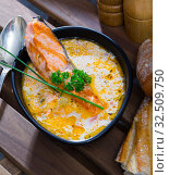 Купить «Creamy soup with salmon with baguette», фото № 32509750, снято 14 декабря 2019 г. (c) Яков Филимонов / Фотобанк Лори
