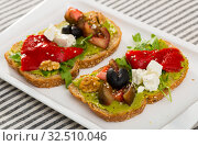 Купить «Sandwich with vegetables, walnut and feta cheese at plate», фото № 32510046, снято 22 июня 2018 г. (c) Яков Филимонов / Фотобанк Лори