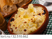 Купить «Appetizing cauliflower and cheese casserole for breakfast», фото № 32510662, снято 6 июля 2020 г. (c) Яков Филимонов / Фотобанк Лори