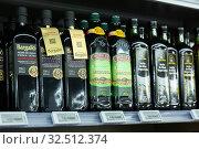 Купить «Bottles of olive oil in supermarket», фото № 32512374, снято 7 ноября 2019 г. (c) Яков Филимонов / Фотобанк Лори