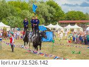 Купить «Russia, Samara, July 2019: Cossacks perform tricks on a galloping horse.», фото № 32526142, снято 28 июля 2019 г. (c) Акиньшин Владимир / Фотобанк Лори