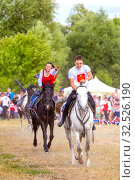 Купить «Russia, Samara, July 2019: Cossacks perform tricks on a galloping horse.», фото № 32526190, снято 28 июля 2019 г. (c) Акиньшин Владимир / Фотобанк Лори