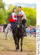 Купить «Russia, Samara, July 2019: Cossacks perform tricks on a galloping horse.», фото № 32526210, снято 28 июля 2019 г. (c) Акиньшин Владимир / Фотобанк Лори