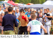 Купить «Russia, Samara, July 2019: an ethno-historical holiday with a reconstruction of the battle of Timur and Tokhtamysh in 1391. Fist fight. Text in Russian: football in the heart of Samara», фото № 32526454, снято 28 июля 2019 г. (c) Акиньшин Владимир / Фотобанк Лори