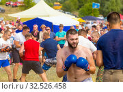 Купить «Russia, Samara, July 2019: an ethno-historical holiday with a reconstruction of the battle of Timur and Tokhtamysh in 1391. Stenosh fight. Competition men wall to wall. Fist fights.», фото № 32526458, снято 28 июля 2019 г. (c) Акиньшин Владимир / Фотобанк Лори