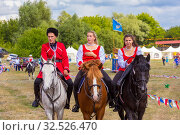 Купить «Russia, Samara, July 2019: Cossacks perform tricks on a galloping horse.», фото № 32526470, снято 28 июля 2019 г. (c) Акиньшин Владимир / Фотобанк Лори