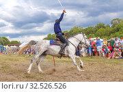 Купить «Russia, Samara, July 2019: Cossacks perform tricks on a galloping horse.», фото № 32526526, снято 28 июля 2019 г. (c) Акиньшин Владимир / Фотобанк Лори