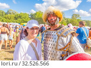 Купить «Russia, Samara, July 2019: an ethno-historical holiday with a reconstruction of the battle of Timur and Tokhtamysh in 1391. Joint photo with the participant of the festival. Warrior in the armor.», фото № 32526566, снято 28 июля 2019 г. (c) Акиньшин Владимир / Фотобанк Лори