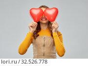 Купить «happy teenage girl with red heart-shaped balloons», фото № 32526778, снято 7 ноября 2019 г. (c) Syda Productions / Фотобанк Лори