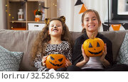 Купить «girls in halloween costumes with pumpkins at home», видеоролик № 32526962, снято 14 ноября 2019 г. (c) Syda Productions / Фотобанк Лори