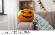 Купить «jack-o-lantern pumpkin at home on halloween», видеоролик № 32526966, снято 14 ноября 2019 г. (c) Syda Productions / Фотобанк Лори