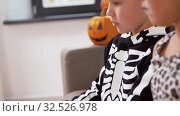 Купить «kids in halloween costumes doing crafts at home», видеоролик № 32526978, снято 14 ноября 2019 г. (c) Syda Productions / Фотобанк Лори