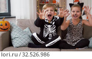 Купить «kids in halloween costumes having fun at home», видеоролик № 32526986, снято 14 ноября 2019 г. (c) Syda Productions / Фотобанк Лори