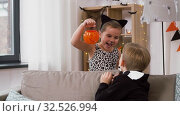 Купить «kids in halloween costumes with jack-o-lantern», видеоролик № 32526994, снято 14 ноября 2019 г. (c) Syda Productions / Фотобанк Лори